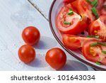 Close up of fresh salad with tomatoes - stock photo