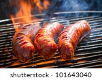 BBQ with fiery sausages on the grill - stock photo