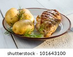 Roasted chicken breast served with potatoes and dill - stock photo