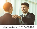 the happy businessmen hold on... | Shutterstock . vector #1016433400