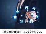 businessman in suit holding... | Shutterstock . vector #1016447308