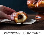 donuts with icing on a brown... | Shutterstock . vector #1016449324