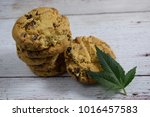 marijuana leaf and cookie on... | Shutterstock . vector #1016457583