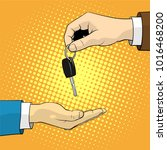 man gives the client a key from ... | Shutterstock . vector #1016468200