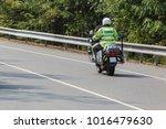 Policeman Riding On A Motorbik...