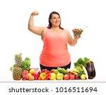 overweight woman holding a bowl ... | Shutterstock . vector #1016511694