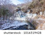 a riverside big icicle ... | Shutterstock . vector #1016519428