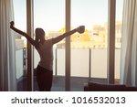 sleepy woman stretching... | Shutterstock . vector #1016532013