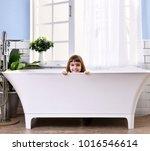 happy little baby girl sitting... | Shutterstock . vector #1016546614