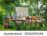 Small photo of Open-air cinema with retro projector in the evening