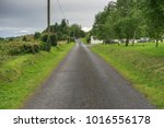 small country road in rural...   Shutterstock . vector #1016556178