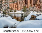 winter fly fishing in red... | Shutterstock . vector #1016557570