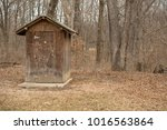 Outhouse In The Woods At A Cam...