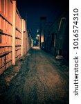 dark and eerie urban city alley ... | Shutterstock . vector #1016574310