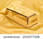 gold bar on satin fabric....   Shutterstock . vector #1016577208