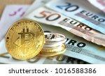 bitcoin coins on euro banknote  ... | Shutterstock . vector #1016588386
