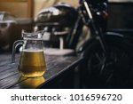 beer on the wooden table with... | Shutterstock . vector #1016596720