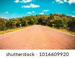 rural road scene lake and... | Shutterstock . vector #1016609920