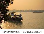 boat sailing over river ganges...   Shutterstock . vector #1016672560