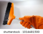 orange rubber gloves and a... | Shutterstock . vector #1016681500