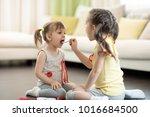 two children girls playing... | Shutterstock . vector #1016684500