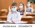 schoolkids with protection mask ... | Shutterstock . vector #1016686474
