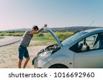 young man looking under the... | Shutterstock . vector #1016692960