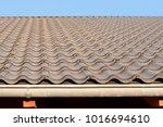 dark tiled roof | Shutterstock . vector #1016694610