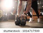 exercising at the gym  | Shutterstock . vector #1016717500