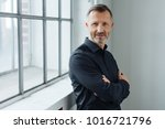 middle aged man standing with... | Shutterstock . vector #1016721796