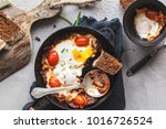 fried eggs with tomato and... | Shutterstock . vector #1016726524