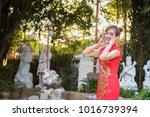 chinese woman wearing... | Shutterstock . vector #1016739394