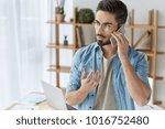 serious handsome bearded male... | Shutterstock . vector #1016752480