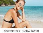 joyful positive female in...   Shutterstock . vector #1016756590