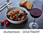 mussels in tomato sauce with... | Shutterstock . vector #1016756659