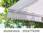 new white awning of coffee shop ... | Shutterstock . vector #1016776240