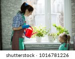 Mom And Daughter Watering...
