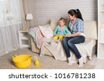 mom and daughter are cleaning... | Shutterstock . vector #1016781238