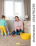 mom and daughter are cleaning... | Shutterstock . vector #1016781250