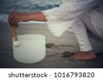 a woman playing a crystal like... | Shutterstock . vector #1016793820