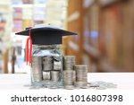graduation hat on the glass... | Shutterstock . vector #1016807398