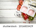 various fruit yoghurts. on a... | Shutterstock . vector #1016833429