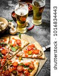 mexican pizza with cold beer.... | Shutterstock . vector #1016834443