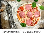 unprepared pizza with... | Shutterstock . vector #1016835490