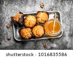 fruit honey muffins. on a... | Shutterstock . vector #1016835586
