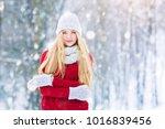 winter young teen girl portrait.... | Shutterstock . vector #1016839456