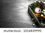 fresh beer in an old box. on... | Shutterstock . vector #1016839990