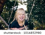 laughing little blonde girl... | Shutterstock . vector #1016852980