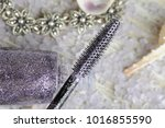 brush of glitter mascara close... | Shutterstock . vector #1016855590