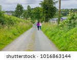 people walking on a country...   Shutterstock . vector #1016863144
